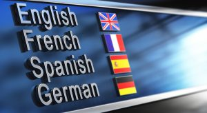 English, French, Spanish and German written on a building facade. Image for illustation of language school