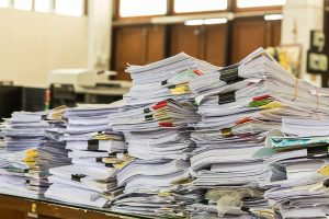 Stacks of documents for translation