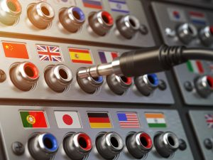 Select language. Learning, translate languages or audio guide concept. Audio input output control panel with flags and plug.