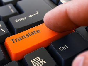 Translate Concept. Person Click on Orange Keyboard Button. Selective Focus. Closeup View.